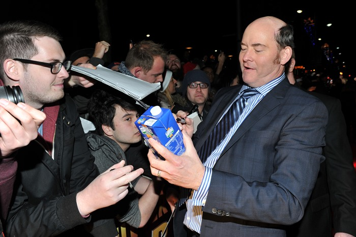 Dublin – 9th December 2013: (l to r:) David Koechner signs a carton of milk at the Dublin Premiere of Anchorman 2 – Credit: Clodagh Kilcoyne for Paramount Pictures International via Getty Images