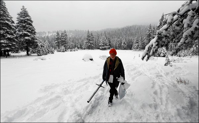 Frank Gehrke, chief of the California Cooperative Snow Survey Program for the Department of Water Resources, leaves a snow-covered meadow after the second snow survey of the year near Echo Summit, California, 30 January 2014. Gehrke said that while recent snow fall will help bolster the depleted snowpack, it is not enough to affect the water supply. Photo: Associated Press