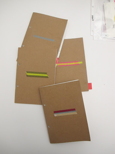 Ayesha labels her notebooks with washi tapes in different colored stripes.