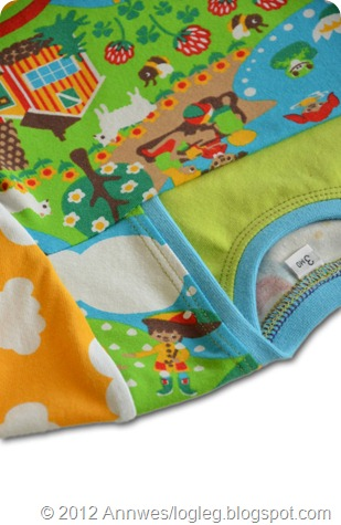 A little boy with an umbrella, upside down on the shoulder. Summer fabric designed by Johanna Ahlard. Sewn by Annwes.