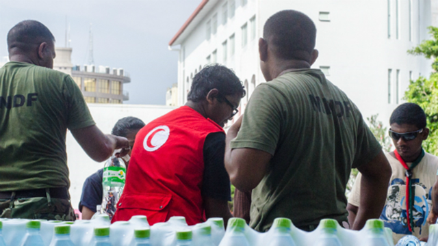 Residents of Male are receiving bottled and desalinated water provided by neighboring countries via public taps and mobile vehicles, on 8 December 2014. The tiny island nation entered its fifth day without drinking water as the government scrambled to repair a major desalination plant after a crippling fire. Photo: Minivan News