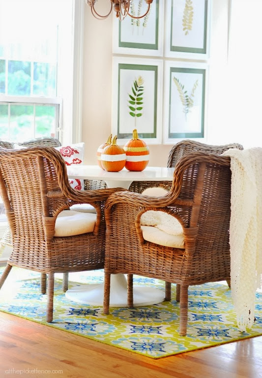 rattan-chairs-and-tulip-table-with-gold-and-white-pumpkins
