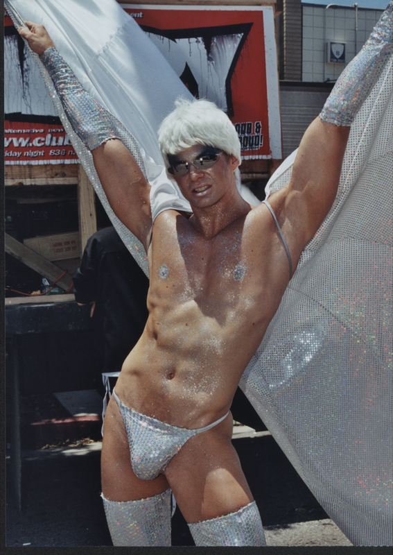 Glittery guy in white at the Los Angeles Christopher Street West (CSW) pride parade. June 13, 1999.