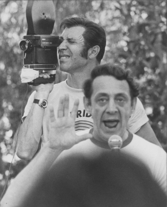 Pat Rocco films from behind as Harvey Milk addresses the crowd. 1978.
