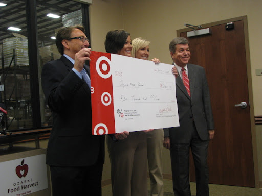 Bart Brown CEO and president of Ozarks Food Harvest, representatives from Target and Congressman Roy Blunt hold the check for $5,000.