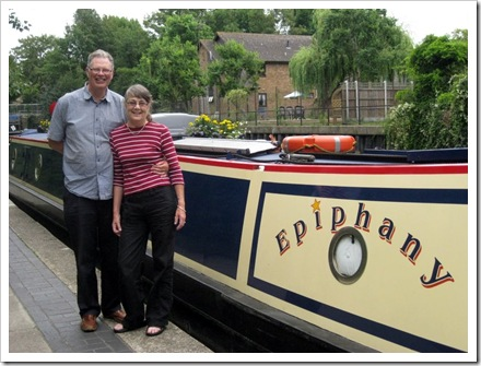 "John and Fiona with narrowboat ""Epiphany"""