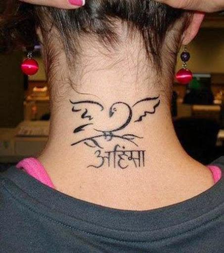 Photos tatouages sur femmes - Tatouage femme sensuelle ...