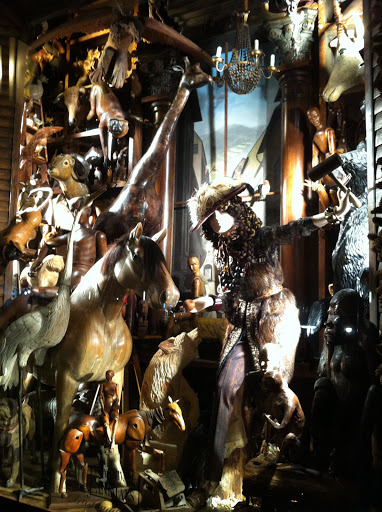 This window had animals carved in wood, taxidermy, leather, and feathers.