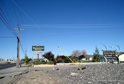 This is the driveway into the park, looking west.  Note the Westwind Homes sign and the smaller Rock Creek RV Park sign.