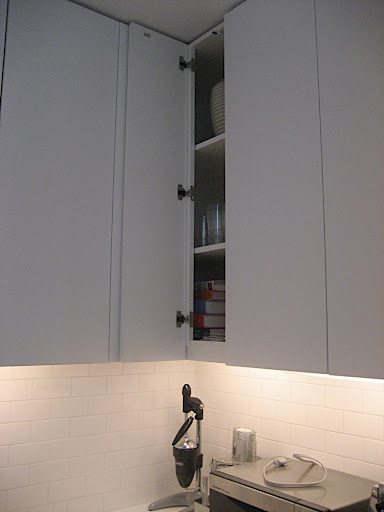 The kitchen has under cabinet lighting as well as some recessed lighting overhead.