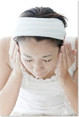 washing face with hot water