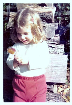 young susan holding lollipops