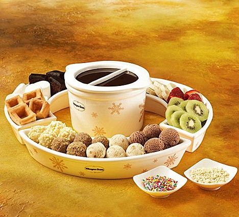 HAAGEN-DAZS ROYAL FONDUE flavours Belgian Chocolate, Caramel Biscuit & Cream, Chocolate, Vanilla coated in almond nibs  freshly baked waffles, marshmallows, brownies, bananas, kiwis strawberries.