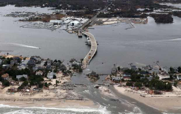 This aerial photo made from a helicopter shows storm damage from Sandy over the Atlantic Coast in Mantoloking, N.J., Wednesday, 31 October 2012. The photo was shot from a helicopter behind the helicopter carrying President Obama and New Jersey Gov. Chris Christie, as they viewed storm damage from superstorm Sandy. Doug Mills / AP Photo