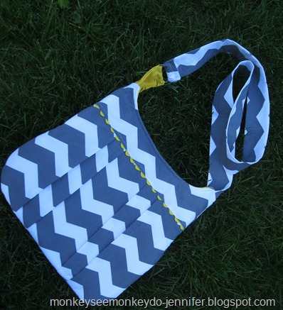 yellow and gray pleated chevron bag