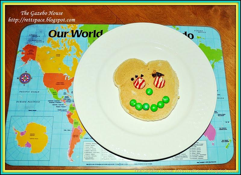OSU  cake, pancakes & snow in arch window 010.jpg framed