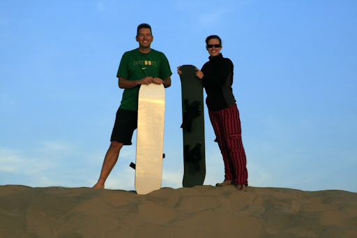 Chris and Lynette, demonstrating the best way of managing to stand upright with a sandboard.