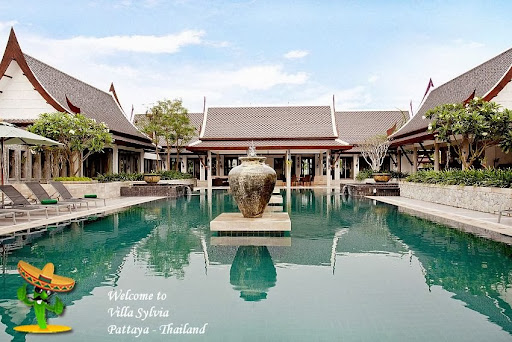5 Bedroom Villa in Pattaya:<br />Snugly tucked away on the outskirts of Na Jomtien, this enchanting Villa will provide you with all the peace and quiet you'll need, whilst being close enough to all the action. Jomtien beach is just ten-minute drive away, and all the other attractions in the region are easily accessible too from this private pool villa for rent at Huay Yai.<br />The U-shaped villa surrounds a private 28sqm swimming pool and there is plenty of parking space in the driveway for guests. Along the left and right wings of the villa are where the bedrooms are located, giving everyone easy access to the pool, which has a copper ionized water filter system that makes the water softer and chlorine free. This water system also runs throughout the rest of the Villa, so you won't have to constantly buy drinking water, you'll be able to drink from the taps.<br />The beautiful lawn, lotus ponds and unique bell at the far end of the garden provide the best vistas imaginable in the incredibly picturesque setting of this 5 bedroom villa in Pattaya. The large covered terrace is the perfect place to take it all in as there are tables and chairs, as well as a comfy settee. To entertain guests you'll have a gas barbeque and a private bar, lined with barstools. It really is perfect for families and groups of friends, as well as weddings and receptions and other events. It's the ideal Villa for any occasion.<br /><br />#Exotic Charm coupled with #Exclusive and #Luxury #Mansions ,  #Villas and  #Apartments in #Thailand you find on http://searchandrelax.com