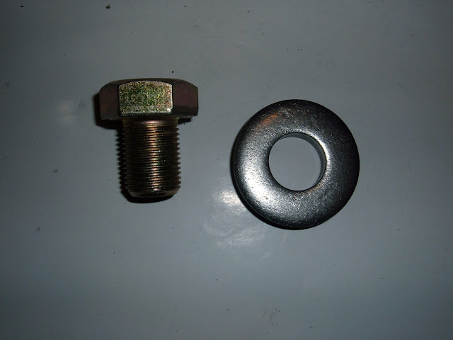 Balancer/dampner bolt and washer, fits all 1957-66 nailheads and some 1955-56 engines. 3/4x16 thread. 12.00 for set new. Must be tightened to 220 lbs!