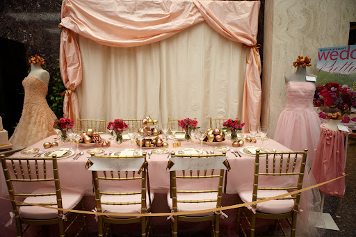 The pink and gold themed wedding reception table