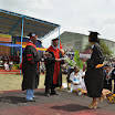 AMU President, Dr Feleke Woldeyes and Vice-President Dr Agena Anjulo honoring on of the graduates.jpg