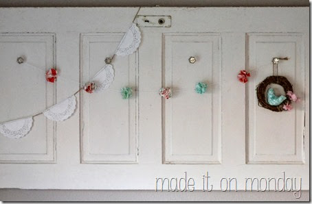 flower puff garland in pinks reds turquoise and greens