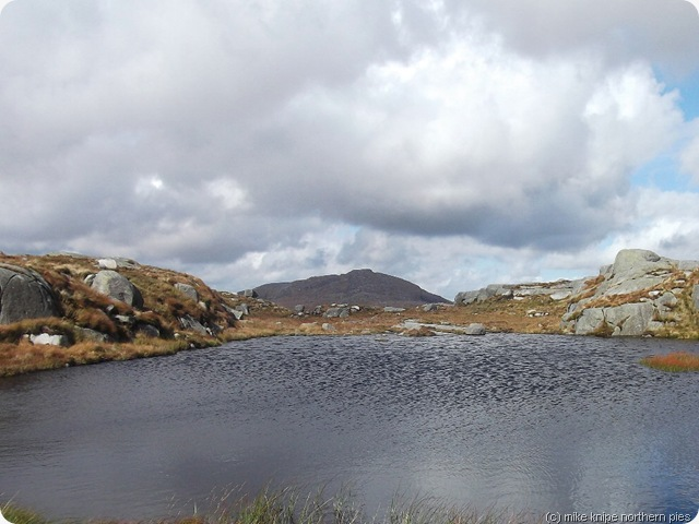dungeon hill peeping over a tarn