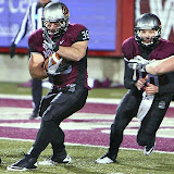 Dan Moore runs the ball after Jordan Johnson handed it off.