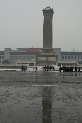 An imposing squad of soldiers marching across Tiananmen square.