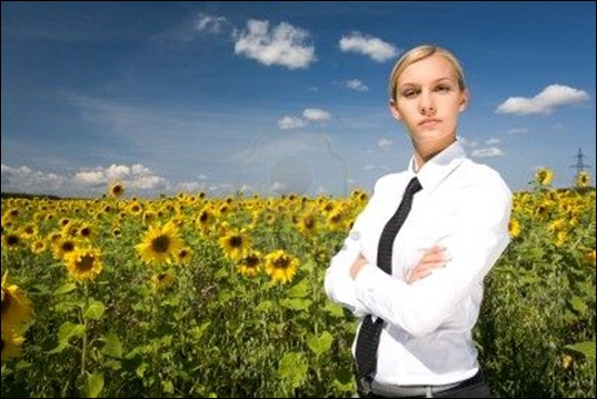 8494134-portrait-of-serious-business-lady-with-folded-arms-in-sunflower-field