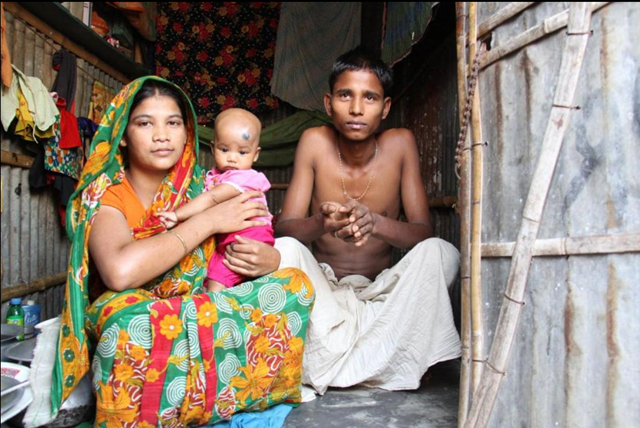 Taslima Masud with daughter Karima and husband Mohammed live in Korail, Dhaka's biggest slum, along with as many as 40,000 other climate change refugees. Photo: Raveena Aulakh / Toronto Star