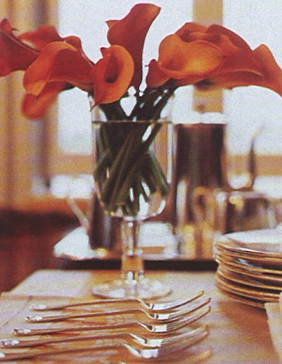 Orange calla lilies decorate the dessert table.