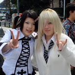 cute Japanese girls rocking peace signs in Harajuku, Tokyo, Japan