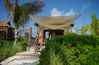 Looking up at a Cabana from the path to the beach.