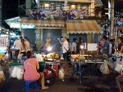 Market and food stalls crowd the streets at night