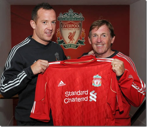 John Powell Picture    06/06 2011 Manager Kenny Dalglish with his new signing Charlie Adam.