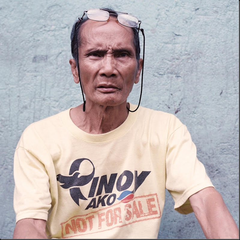 Portrait of an elder citizen of a local neighborhood called Daangtubo, a small community residing on a strip of land owned by the government. After more than sixty years of settling infomally, residents are now threatened with eviction after the government plans to reclaim the area.