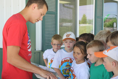 Ben Temple of Crawfordsville shared his personal story of being in a lawn mower accident at the age of 4.  He tried to jump on a moving mower and slipped.  His story was powerful for youth to hear first hand.  He showed the dangerous moving parts on a mower and also shared pictures of his foot then and now.  Photo Courtesy:  ISU Extension.