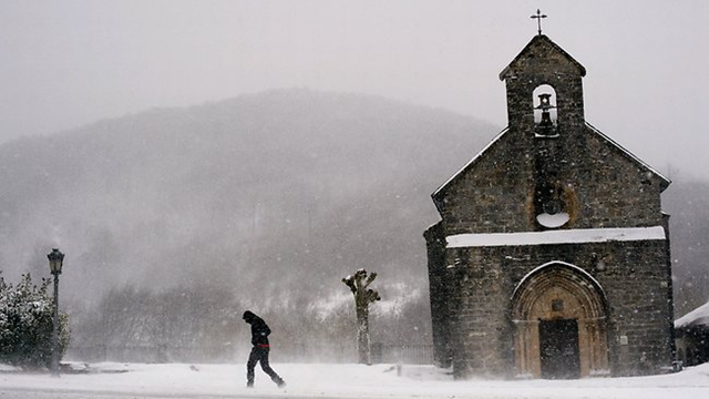 Winter chill: A man braves freezing temperatures in Spain, as the death toll from Europe's cold snap continued to rise, 3 February 2012. Picture: AP