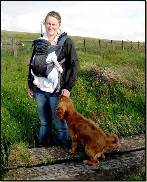 Mum, baby, and dog, all enjoying the freedom offered by the Vaude Soft 111 Baby Carrier