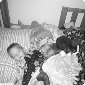 Twins sleeping together in the bunk bed