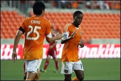 May 29, 2013; Houston, TX, USA; Houston Dynamo forward Brian Ching (25) congratulates midfielder Alex Dixon (19) after scoring a goal during the first half against FC Tuscon at BBVA Compass Stadium. Mandatory Credit: Troy Taormina-USA TODAY Sports