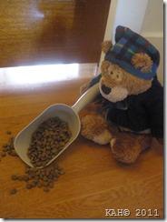 Sleepy Bear Spills the Scoop of Dog Food