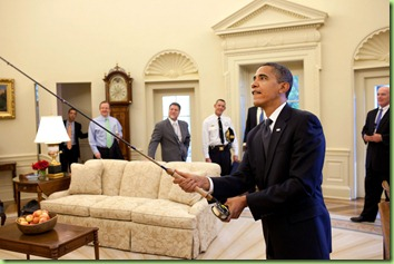 President Barack Obama tries out the fly fishing rod given to him on his birthday by a group of avid fisherman on his staff, August 4, 2009. (Official White House Photo by Pete Souza)&#10;&#10;This official White House photograph is being made available only for publication by news organizations and/or for personal use printing by the subject(s) of the photograph. The photograph may not be manipulated in any way and may not be used in commercial or political materials, advertisements, emails, products, promotions that in any way suggests approval or endorsement of the President, the First Family, or the White House. &#10;