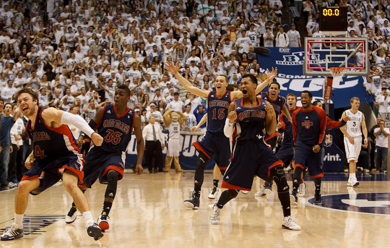 Saint Mary's players celebrate after Saint Mary's guard Matthew Dellavedova (4) hit a last-second shot to win the game. BYU hosts Saint Mary's, college basketball Wednesday January 16, 2013 in Provo