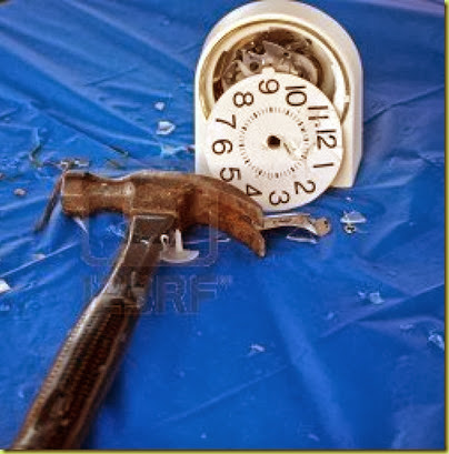 3385988-hammer-and-smashed-alarm-clock-on-blue-tablecloth