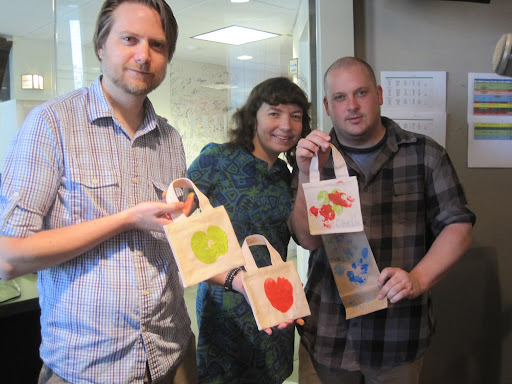 Scott (left), Maura, and Chris show off the finished crafts.