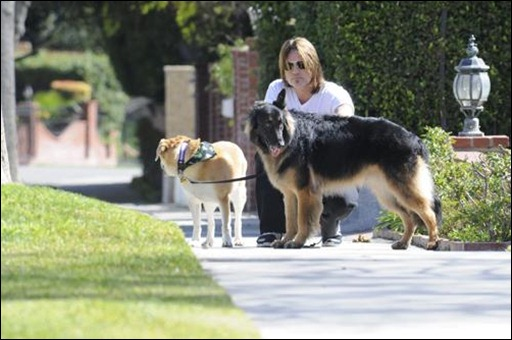 Singer and actor Billy Ray Cyrus takes his two dogs out for a walk around his neighborhood in Toluca Lake