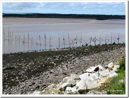 Salmon fisherman's poles across the river Cree estuary.