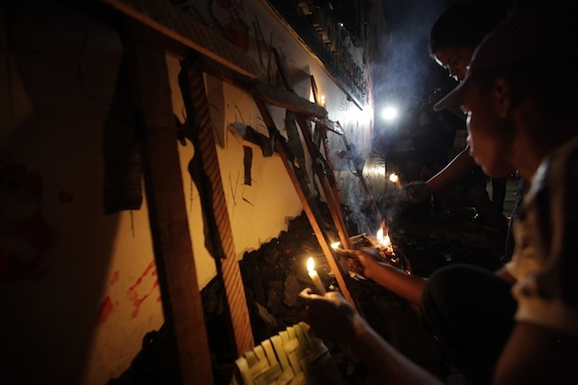 Activists hold candles during a vigil on the night after the first day of the trial of Zé Rodrigues and his brother, Lindonjonson Silva, and Alberto Nascimento, in the murder of Amazon forest activists Zé Claudio and Maria do Espirito Santo. On 15 April 2013, Lindonjonson was found guilty and sentenced to 42 years in jail, Alberto Nascimento was found guilty and sentenced to 45 years in jail, but Zé Rodrigues was acquitted. Photo: VICE